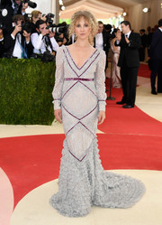 Juno Temple exuded vintage glamour at the Met Gala in a silver Erdem fishtail gown with purple piping.