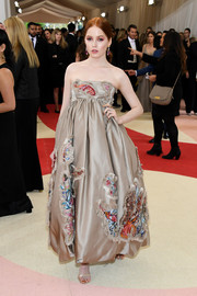 Ellie Bamber was a vision in a voluminous gold empire gown by Giles Deacon during the Met Gala.