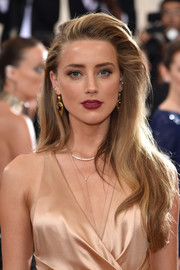 Amber Heard wore her long hair loose with a teased top during the Met Gala.