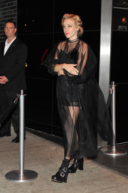 Chloe Sevigny put lots of skin on display in a sheer black dress while attending a Met Gala after-party.