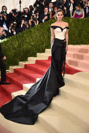 Emma Watson layered a nude corset over a black off-the-shoulder top, both by Calvin Klein, for her Met Gala look.