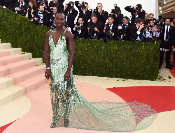Lupita Nyong'o (in Calvin Klein) as Tiana