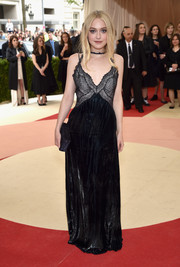 Dakota Fanning was a goth beauty at the Met Gala in a black lace-bodice slip dress by Nina Ricci.