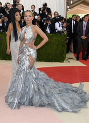 Rita Ora was dressed to make jaws drop in a Vera Wang cutout gown embellished all over with silver feathers!