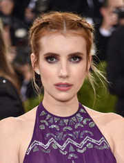 Emma Roberts rocked punk-girl braids on the Met Gala red carpet.
