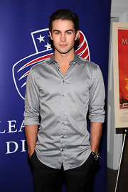 Chace Crawford paired his black slacks with a gray button down shirt.