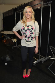 Black skinny pants were casual for Nastia Liukin's backstage look at Mara Hoffman.