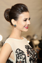 Victoria Justice exuded classic sophistication with this braided bun during the Mara Hoffman fashion show.