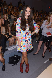 Chloe Bridges rocked a retro vibe in a colorful print dress during the Mara Hoffman fashion show.