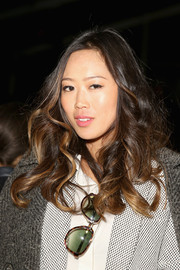 Aimee Song left her hair loose with bouncy waves when she attended the Mara Hoffman fashion show.