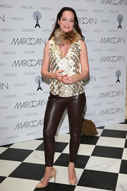 Natalia Woerner chose a cream and golden sleeveless top with a fur collar for her look at the Marc Cain photo call.