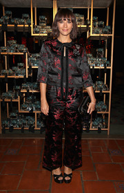 Rashida Jones attended the Marc Jacobs Divine Decadence event wearing a black and red cherry blossom-embroidered pantsuit from the label.