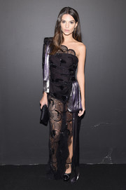 Emily Ratajkowski caught stares in a sheer black one-shoulder gown by Marc Jacobs while attending the label's fashion show.
