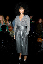 Tracee Ellis Ross donned a silver open-weave cardigan by Marc Jacobs for the brand's Fall 2019 show.