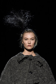 Karlie Kloss looked fancy with her feathered headpiece at the Marc Jacobs runway show.