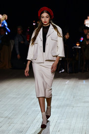 Gigi Hadid walked the Marc Jacobs Fall 2020 runway show wearing a pale pink skirt suit.