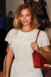Bijou Phillips attended the #PATCHMARC event carrying a classic Chanel quilted bag, in red.