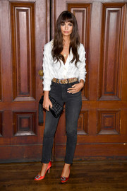 A tasseled cage clutch by Carolina Santo Domingo sealed off Emily Ratajkowski's ensemble.