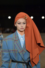 Gigi Hadid looked exotic wearing this rust-colored head scarf on the Marc Jacobs runway.