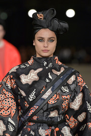 Taylor Hill walked the Marc Jacobs show wearing a black satin head wrap and a printed jumpsuit.