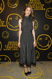 Sofia Coppola paired her cute frock with black ankle-strap peep-toes.