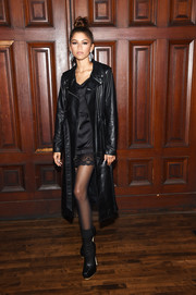 Zendaya Coleman sealed off her edgy ensemble with black ankle boots.