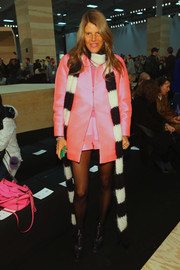 Anna dello Russo attended the Marc by Marc Jacobs fashion show looking fun and bright in a bubblegum-pink short suit.