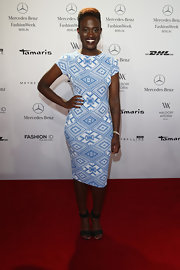 Ivy Quainoo chose an abstract-print blue and white fitted frock for her look at the Marc Stone runway show in Berlin.