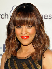 Tia Mowry went for a standout beauty look with a swipe of bright orange lipstick.