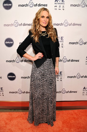 Molly Sims paired a long print skirt with a structured blazer for her red carpet look during the March of Dimes celebration of Babies Luncheon.