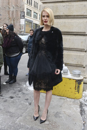 Sarah Paulson went for all-out glamour with this black fur coat and lace LBD combo during the Marchesa fashion show.