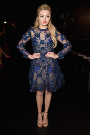 Peyton List cut a sophisticated figure in a floral-embroidered cocktail dress at the Marchesa fashion show.