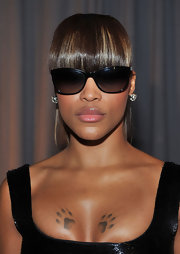 Eve wore a ponytail and blunt bangs when she attended the 2011 Marchesa fashion show.
