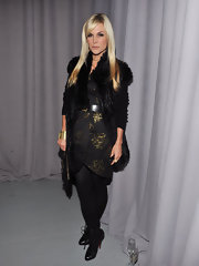 Tinsley Mortimer accented her textured black look with black lace up snakeskin boots.
