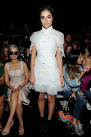 Olivia Culpo attended the Marchesa fashion show wearing this flouncy white confection, the brand's ultra-feminine take on the classic shirtdress.