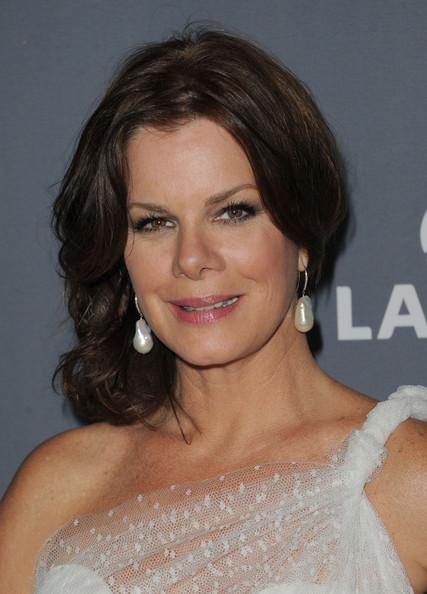 Marcia Gay Harden Dangling Pearl Earrings [hair,face,hairstyle,eyebrow,chin,lip,shoulder,beauty,brown hair,blond,marcia gay harden,lacoste - arrivals,lacoste,hotel,california,beverly hills,the beverly hilton,sponsor,costume designers guild awards]