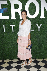 Margherita Missoni looked demure in a white peplum jacket during the debut of her collaboration with Peroni Nastro Azzurro.