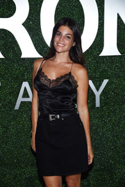 Julia Restoin-Roitfeld paired a black denim mini skirt with a lacy cami for the Margherita Missoni x Peroni Nastro Azzurro collaboration debut.