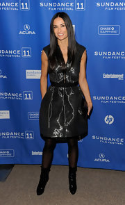 "Demi Moore debuted an edgier look at the ""Margin Call"" premiere in black patent Trixie platform boots trimmed with fur."