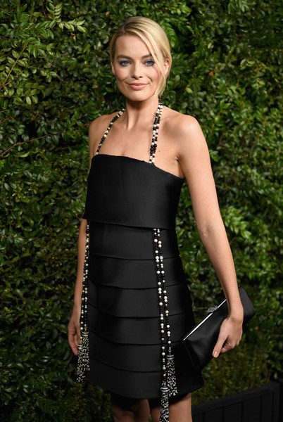 Margot Robbie Satin Clutch [clothing,dress,cocktail dress,shoulder,little black dress,lady,strapless dress,fashion,fashion model,blond,charles finch,margot robbie,chanel pre-oscar awards,dinner,beverly hills,california,madeo,madeo in beverly hills,chanel]