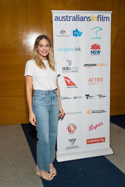 Margot Robbie High-Waisted Jeans [once upon a time,fashion,shoulder,denim,jeans,advertising,carpet,flooring,australians in film host screening of ``once upon a time in hollywood,margot robbie,film screening,hollywood,beverly hills,california,writers guild theater]
