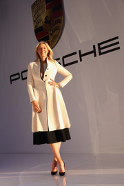 Maria Sharapova looked sharp in a white wool coat with black trim during the presentation of her personalized Porsche Panamera GTS.