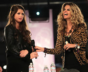 Katherine Schwarzenegger toughened her black shift with a classic black leather jacket.
