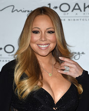 Mariah Carey made an appearance at 1 OAK Nightclub wearing a flawlessly styled feathered flip.
