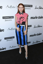 Madelaine Petsch amped up the vibrant vibe with a boldly striped pencil skirt, also by Prada.
