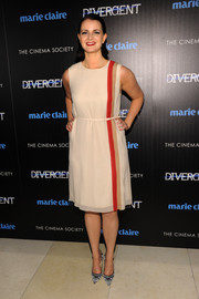 Amy Newbold donned a cream-colored cocktail dress with red and nude stripe detail for the 'Divergent' screening in NYC.