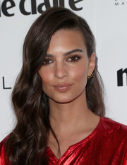 Emily Ratajkowski contrasted her bold-colored outfit with a nude lip.