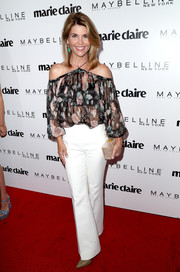 Lori Loughlin teamed her cute top with white flare pants.
