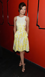 Olivia Wilde looked simply stunning in a white and yellow print dress.