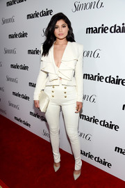 Kylie Jenner chose a white ruffle jacket and skinny pants combo for the Marie Claire Fresh Faces party--Balmain's super-flirty take on the classic pantsuit!
